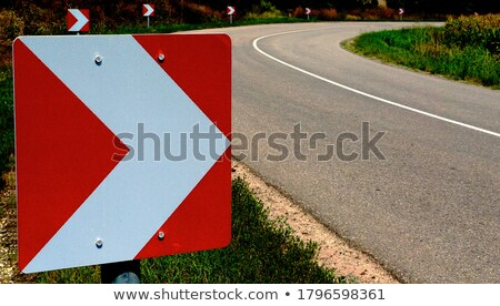 Directions indicator red sign Stock photo © frimufilms