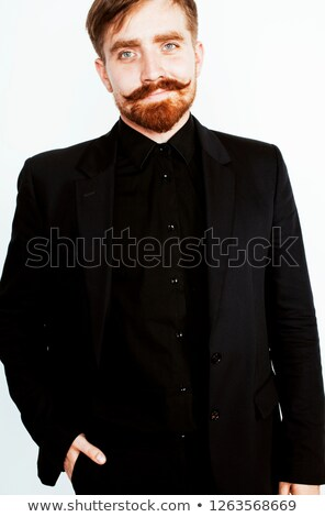 young red hair man with beard and mustache in black suit on whit Stock photo © iordani