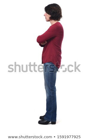 Full length portrait of woman standing sideways with crossed arm Stock photo © deandrobot