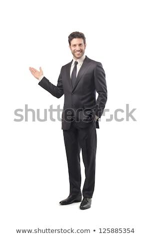 Businessman presents something Stock photo © NikoDzhi
