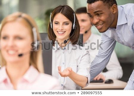 Férfi felügyelő beszél ügyfélszolgálat asztal iroda Stock fotó © wavebreak_media