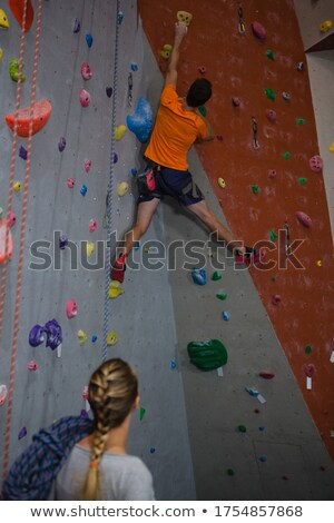 Woman preparing for rope climbing in fitness studio Stock photo © wavebreak_media