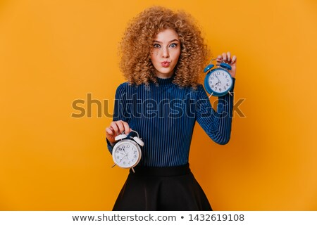 beautiful blonde with blue eyes posing on a yellow background Stock photo © dmitriisimakov