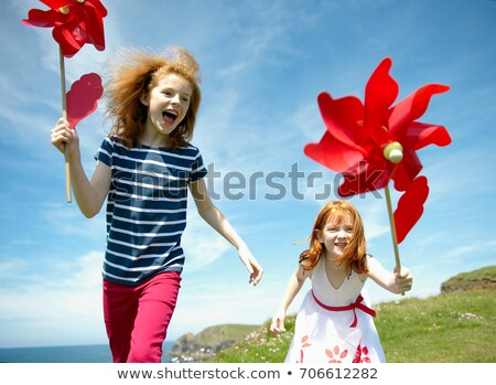 2 girls laughing with red windmills Stock photo © IS2