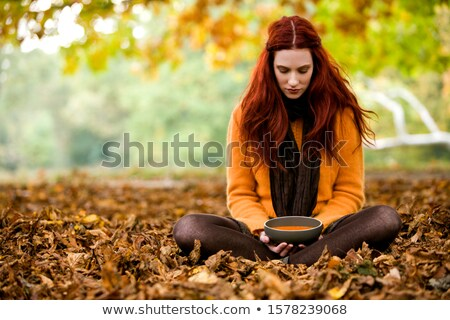 woman sitting in front of vegetables Stock photo © IS2