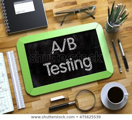 A/B Test Concept on Small Chalkboard. Stock photo © tashatuvango