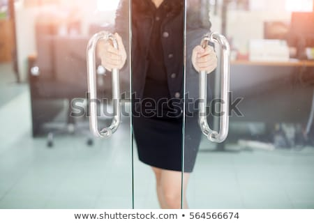 woman at glass door Stock photo © IS2