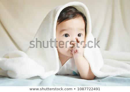 Stock photo: Baby sucking thumb