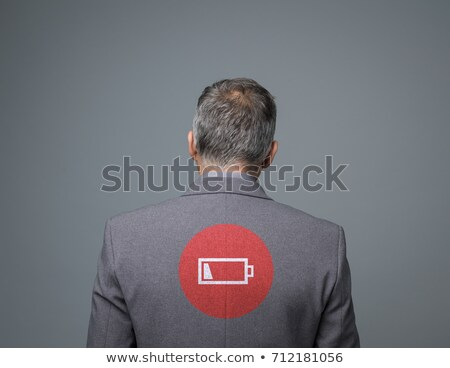 Exhausted businessman with low charge icon Stock photo © stokkete