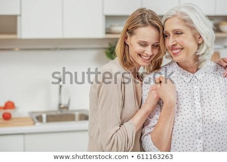 idős · anya · lánygyermek · mosolyog · felnőtt · szeretet - stock fotó © FreeProd