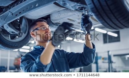 Mechanic working under car Stock photo © monkey_business