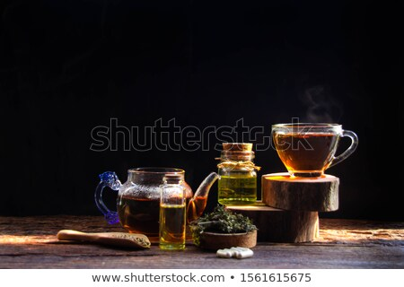 Hennep kruidenthee houten achtergrond groene thee Stockfoto © joannawnuk