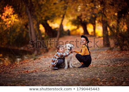 two little girls sister friends golden retriever puppy dog stock photo © lunamarina