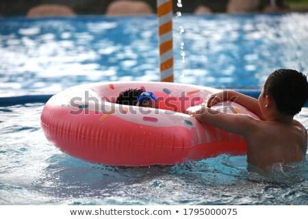fiú · úszik · gumi · gyűrű · medence · úszómedence - stock fotó © deandrobot