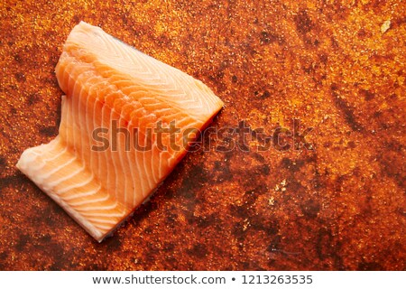 Raw fresh salmon meat placed on rusty metal background Stock photo © dash