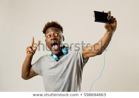 портрет молодые афроамериканец человека улыбаясь Сток-фото © deandrobot