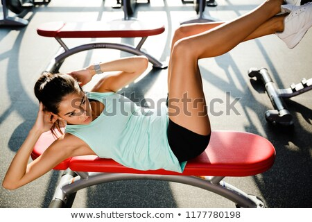 Above view of Amazing sports woman doing abs exercise Stock photo © deandrobot