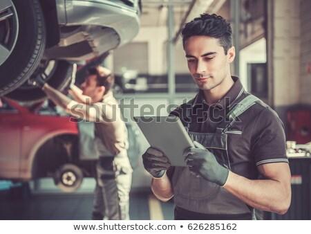 Szerelő tabletta garázs kék dolgozik munkás Stock fotó © Minervastock