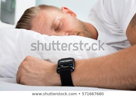 férfi · alszik · okos · óra · kéz · mutat - stock fotó © andreypopov