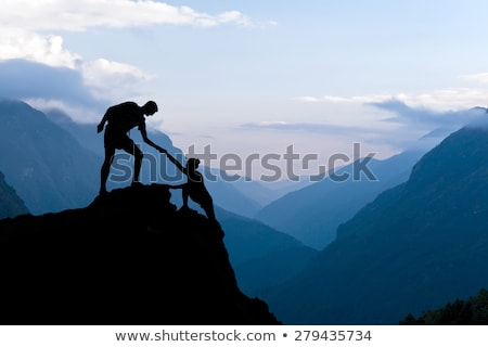 Stock photo: Teamwork couple helping hand trust in inspiring mountains
