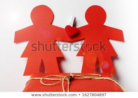 Kadın çift beyaz kâğıt resim yazı kırmızı Stok fotoğraf © dolgachov