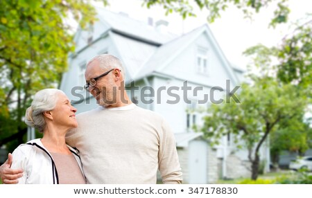 happy senior couple over living house background Stock photo © dolgachov