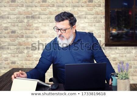 Video call boss. man is late Stock photo © studiostoks
