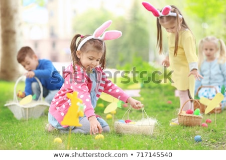 Little girl playing with Easter eggs Stock photo © Anna_Om