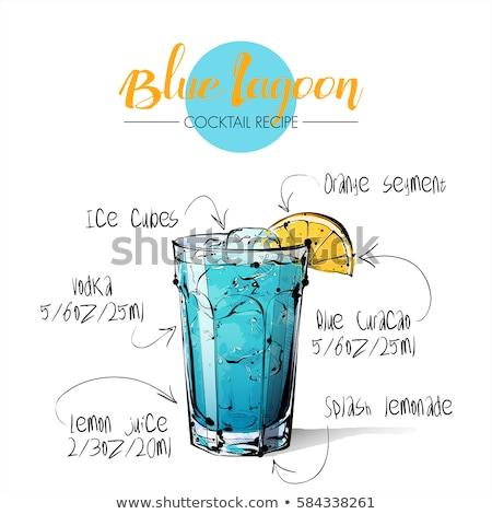 Blue lagoon cocktails with ice cubes, lemon on black Stock photo © dla4