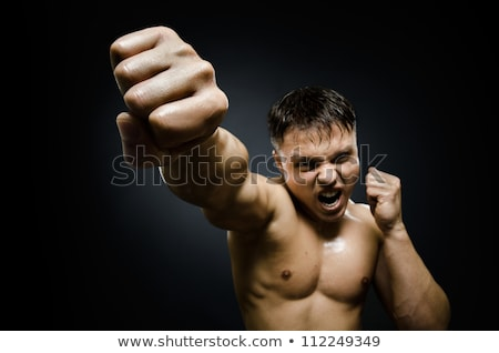 Furious belligerent man punching the camera Stock photo © Giulio_Fornasar