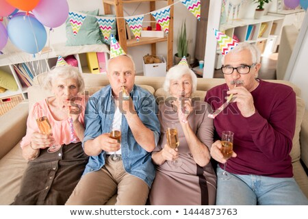 Group of senior friends or two couples blowing whistles Stock photo © pressmaster