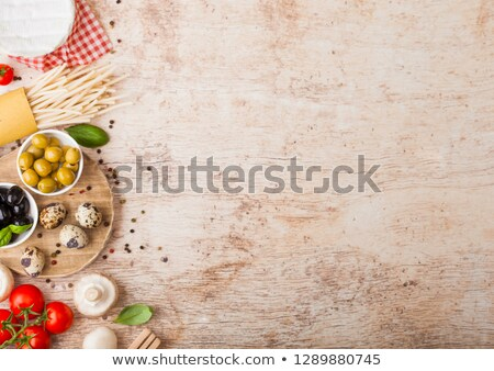 Homemade wheat bread with quail eggs and raw wheat and fresh tomatoes on wooden background. Classic  Stock photo © DenisMArt