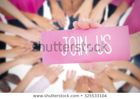 Join Us Text and Hand holding card with pink breast cancer awareness women Stock photo © wavebreak_media