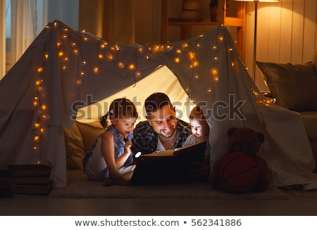 Apa játszik kicsi baba lánygyermek otthon Stock fotó © dolgachov