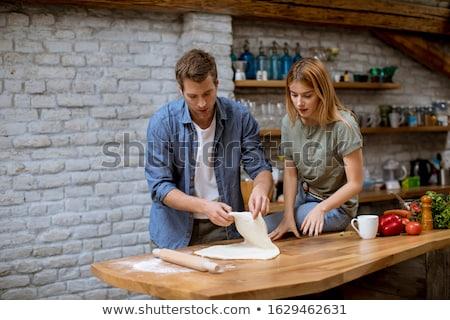 fiatalember · konyha · házi · készítésű · pizza · eszik · iszik - stock fotó © boggy