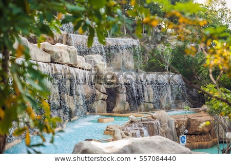 Artificial waterfall in the park of mineral springs stock photo © galitskaya