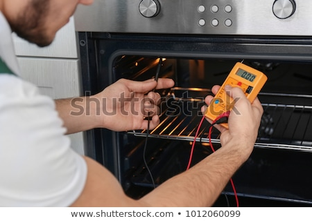 Technicians Repairing The Oven In Kitchen stock photo © AndreyPopov
