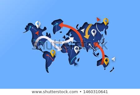 World map blue papercut gps travel arrow concept Stock photo © cienpies