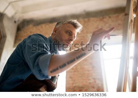 Sérieux attentif peintre travail nouvelle peinture Photo stock © pressmaster