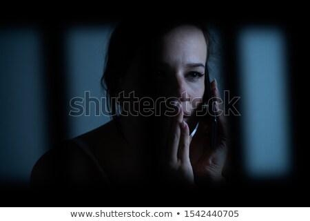 Fogoly nő mobiltelefon börtön lány nők Stock fotó © AndreyPopov
