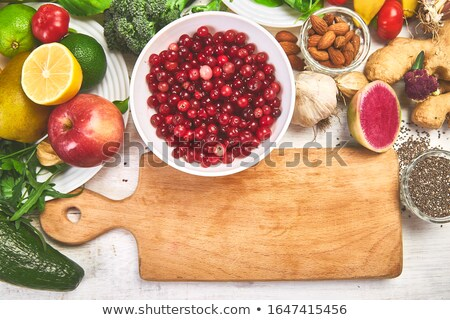 selection of rich in antioxidants and vitamins and mineral around cutting board stock photo © illia