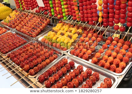 Traditional Chinese Dessert - Candied Fruit on a Wooden Stick Stock photo © galitskaya