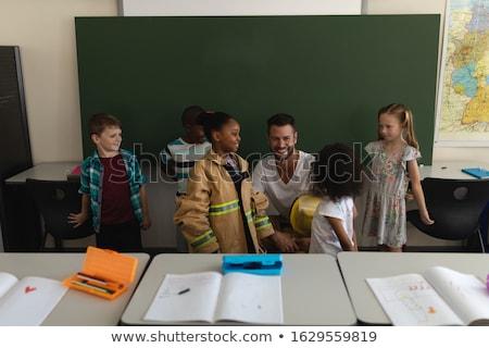 Frente vista caucásico bombero ensenanza Foto stock © wavebreak_media