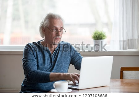 Worried Man At Computer With System Failure On The Screen Stock photo © AndreyPopov