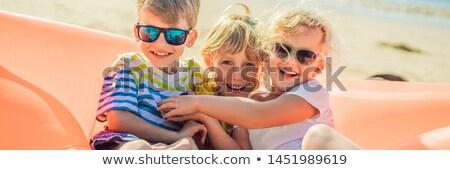 Crianças sentar-se inflável sofá mar diversão Foto stock © galitskaya