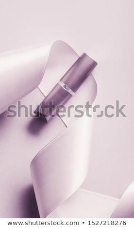Luxury lipstick and silk ribbon on blush purple holiday backgrou Stock photo © Anneleven