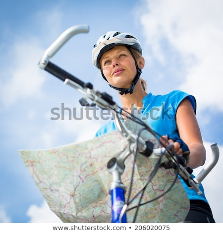 Female cyclist, reading a map, finding her way Stock photo © lightpoet