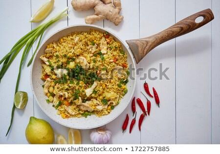 Delicioso frito arroz frango legumes servido Foto stock © dash