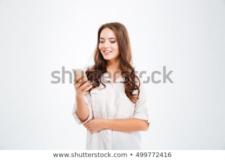 Concentrated pretty woman using mobile phone. Stock photo © deandrobot