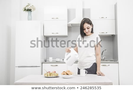 Woman making morning tea Stock photo © eddows_arunothai